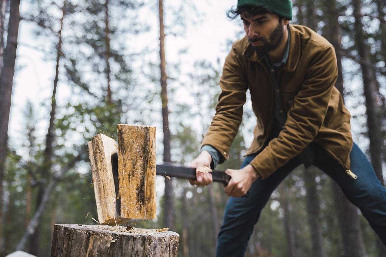 C:\Users\PC\Downloads\man-chopping-wood-in-rural-landscape.jpg