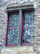 Photo: Saw this glass in a few places. Really interesting looking, like the bottoms of lots of bottles.