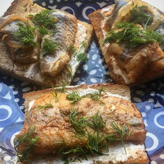 Pickled Herring on Rye Toast.