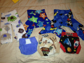 Photo: Newborn Fleece.... Top Three WAHM Longies. elephant longies (REALLY small, won't fit for long but great for those first weeks) $3. Mickey Longies $4 each. Swaddlebees Newborn wrap with aplix $4, Bugga Bugga Boutique soakers $6 each