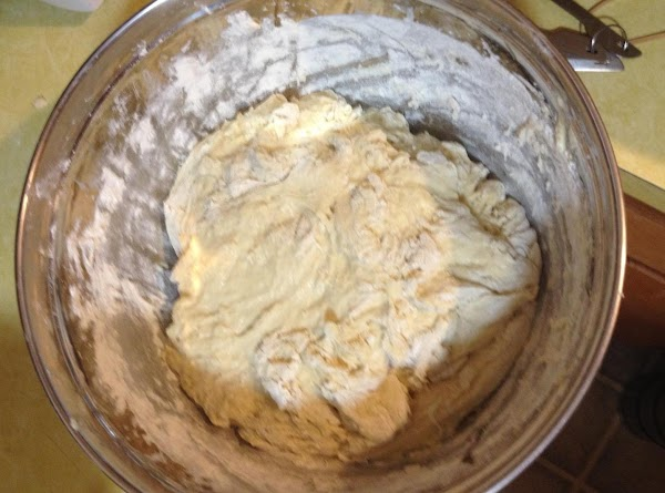 Start incorporating the flour into the liquid.  Start with 3 cups flour, mixing...
