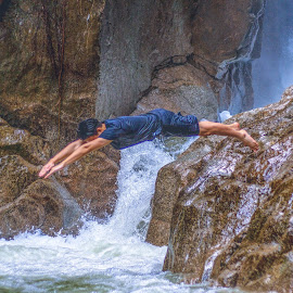 Jump Shot  by Lydelter  Bolodin  - Sports & Fitness Swimming ( jungle trekking, cliffs, nature, wet, confidence, hiking, water, outdoor, diving, rocks, waterfall, river, jump )