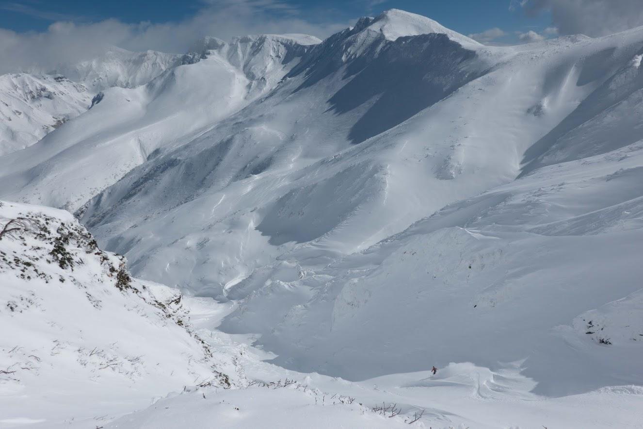 Etienne skiing off of Furano-dake's Giant Ridge