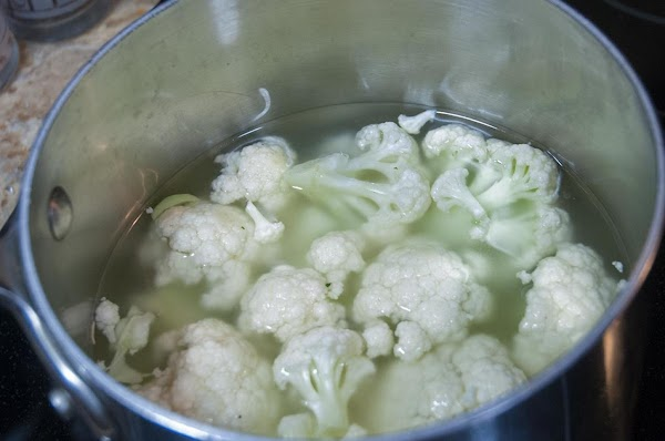 Add the cauliflower to a pot, and cover with water, or 50% water and...
