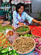 Photo: vendor of chillies, cooking tamarind and aromatic herbs