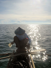Photo: Late afternoon sun on our boatman