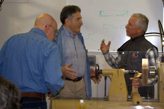 Photo: Clif Poodry shares a discussion with demonstrator Mike Sorge, as Mike Colella looks on.