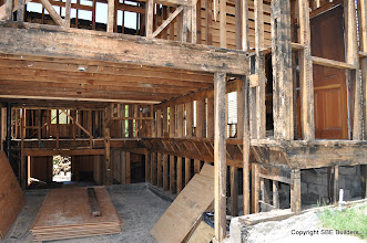 Photo: The 2x10 floor joist with termites needs to be replaced. As well as some of the studs to the right of the garage.