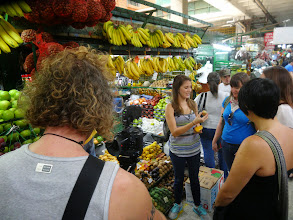 Photo: Marcela leading a fruit tour at the Minorista market