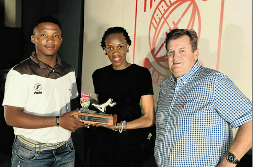 STAR EFFORT: Cricketer of the Week Sinethemba Qeshile receives his award from Phindile Phiri and Neels Momberg during the Coca-Cola Khaya Majola Week Gala Dinner in Soweto this week Picture: GALLO IMAGES