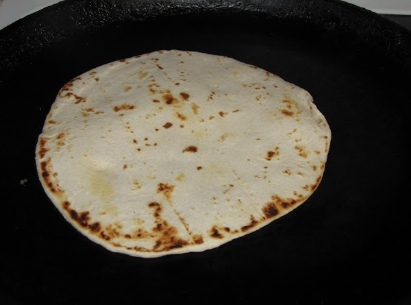 Heat skillet on med high heat and heat tortilla's a minute or two on...