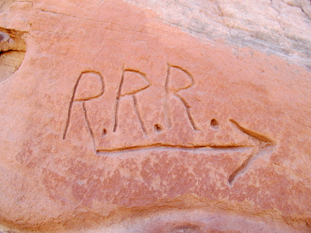 R.R.R. (probably pointing toward Robber's Roost Ranch)