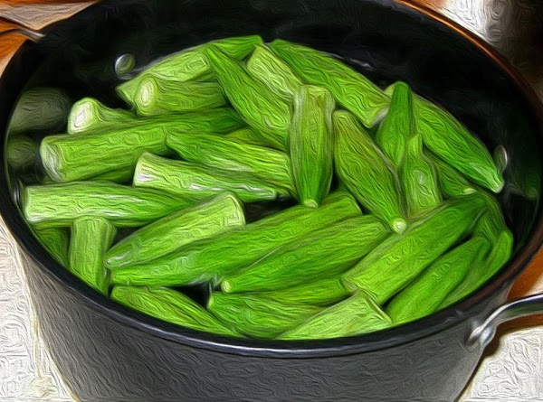 Okra should be clean, halved and patted dry. Dip okra into the batter, and allow...