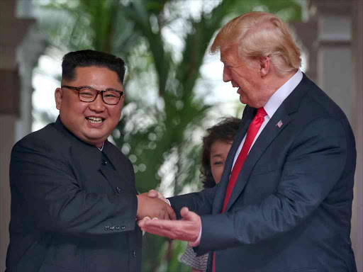 US President Donald Trump meets North Korean leader Kim Jong Un at the Capella Hotel on Sentosa island in Singapore, June 12, 2018. /REUTERS