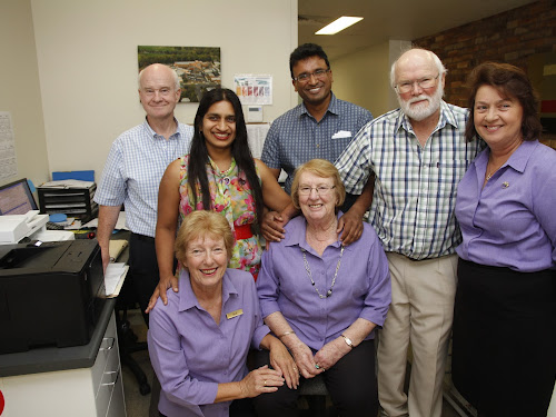 Fifty one years and counting - but The Bridge Medical Centre practice manager Carol Connole, seated centre, has no plans for retirement. Colleagues of many years and recent additions to the team, back, Dr Kerry Moroney, Dr Dilini, Dr Rohana, Dr Andrew Paas and co-receptionist Rosemary Lampe and Audrey Shepherdson, front left.