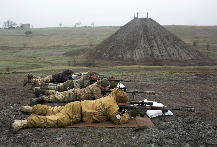 Snipers of the Ukrainian armed forces aim their rifles during training at a firing range near the town of Marinka in the Dombass region, Ukraine, April 13 2021. Picture: REUTERS/ANASTASIA VLASOVA