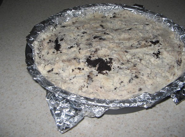 Line  one of the 8 inch cake pans with foil and fill with...