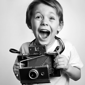 Instant Excitement  by Gregg Eisenberg - Babies & Children Children Candids ( 1960's, expression, bellows, photograph, white backround, holding, retro, equipment, cute, photography, caucasian, kid, eyes, child, chic, lifestyle, casual, photographer, nostalgia, 60, instant, photographic, film, vision, vintage, camera, old-fashioned, image, photo, young, lens, portrait, picture, shutter, memories, boy, shooting, kitsch )