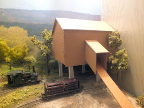 """Photo: 004 Another view of the outline shell of the under-construction mine building and a first glimpse of 50% of the line's motive power in the shape of 0-6-0ST """"Creech"""" ."""