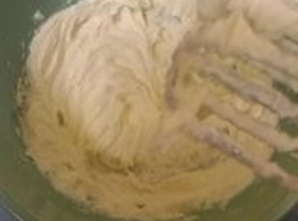 In a large bowl, beat the softened cream cheese with an electric mixer until...