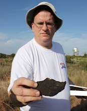 Photo: Tom Penders holding prehistoric sherd from site on Patrick Air Force Base, Cape Canaveral.  Penders is an FSU Anthropology alumni.