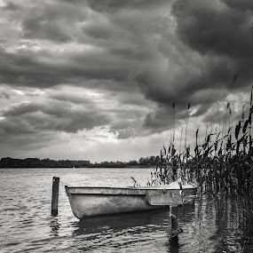 Boat on the river bank.  by Dmitriy Yanushevichus - Transportation Boats ( clouds, b&w, hdr, black and white, lake, dinghy, storm, boat, panorama, river )