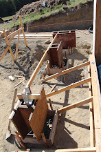 Photo: Piers for porches being poured with slab