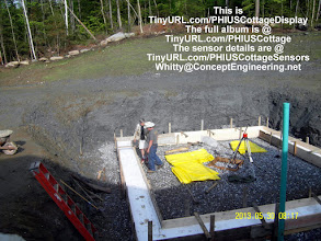 """Photo: Gerg & Chris w/ 8"""" of 44psi EPS in the footing forms ..."""