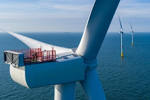 Workers look out from atop an offshore wind turbine in the Belgian North Sea.