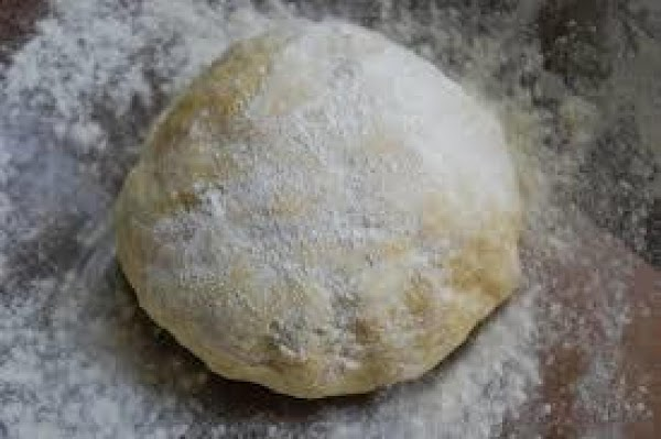 On a clean flat surface sprinkle a little flour. Knead one loaf at a...