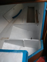 Photo: forward quarterberth lockers with two coats of primer and one top coat applied