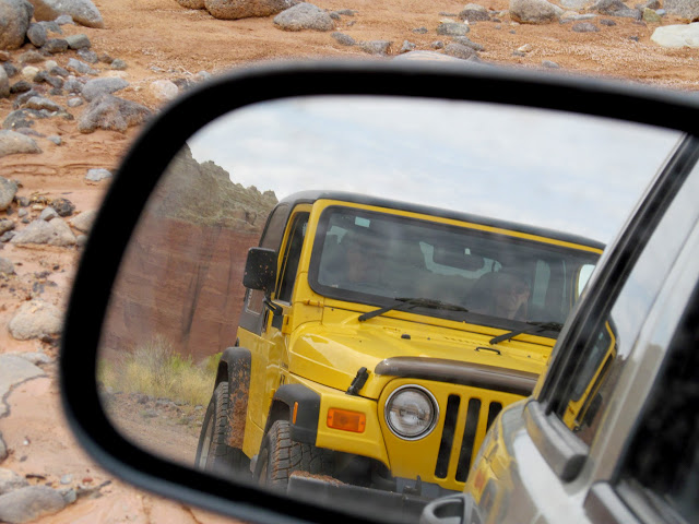 Yellow Jeep in the side mirror
