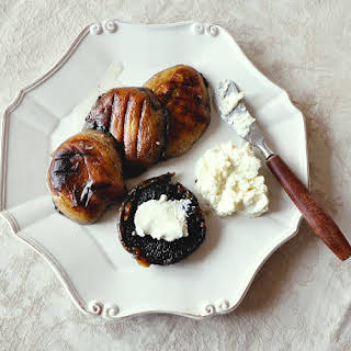 Grilled Portobello mushrooms with ricotta and garlic.