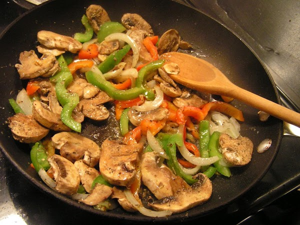 Heat EVOO in skillet; add onions, garlic, peppers and mushrooms.  Sprinkle with ...
