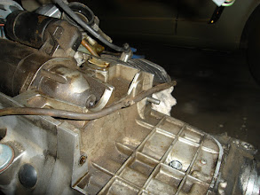 Photo: Carburetor vacuum hoses, which feed into the airbox through that t-fitting.