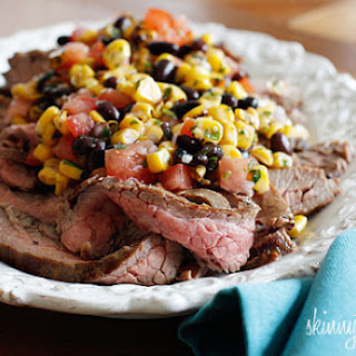 Grilled Flank Steak with Black Beans Corn and Tomatoes.