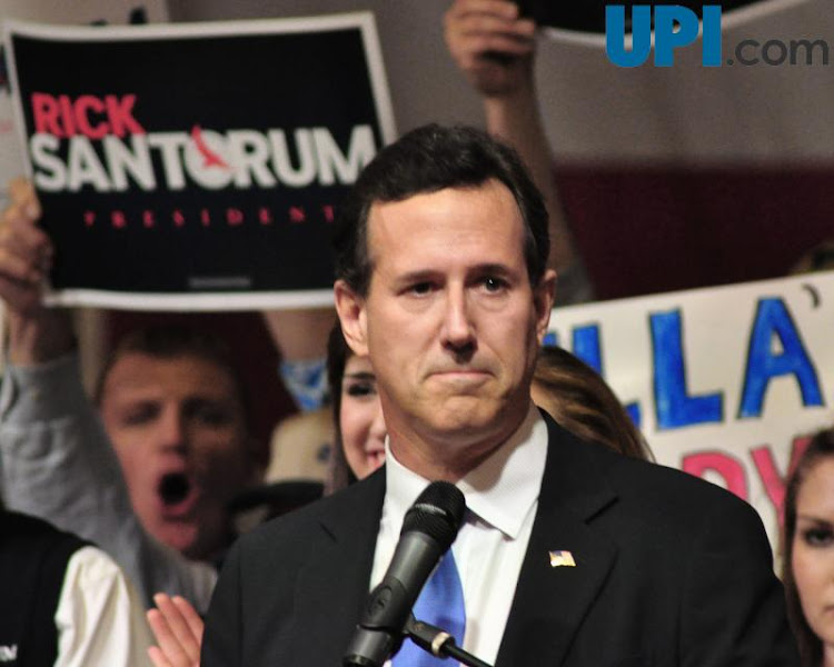 Photo: Republican presidential hopeful Rick Santorum pauses while addressing his supporters at the Super Tuesday Election Night Party in the gymnasium of the Steubenville High School in Steubenville, Ohio March 6, 2012.