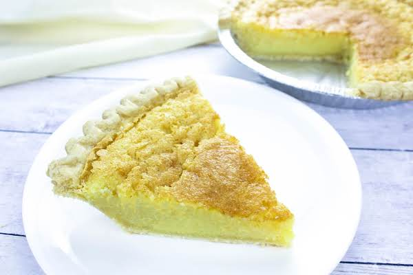 A Slice Of Deep Dish Buttermilk Chess Pie On A Plate.