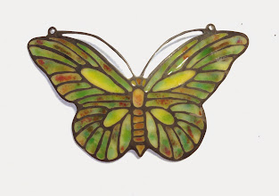 Photo: Plique-à-Jour Enamel Jewelry - Pendant - Medium Green Butterfly - Fine Silver, Plique-a-Jour Transparent, Semi-Opaque, and Opalescent Enamels - approximately 29mm (h) x 48mm (w) - $475.00 US This butterfly is a miniature depiction of a Tiffany lamp screen.