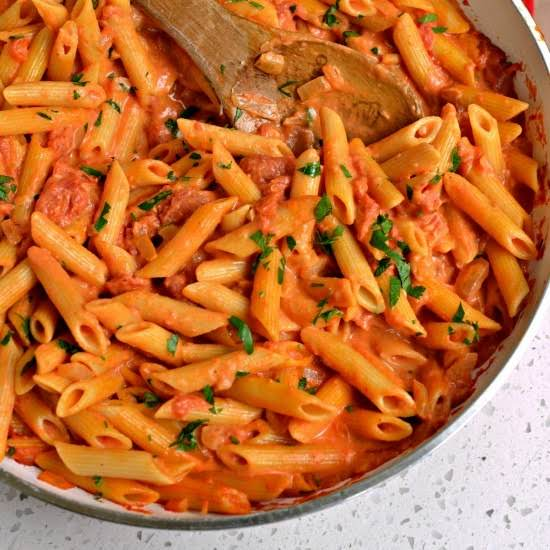 Penne Alla Vodka Is Penne Pasta In A Rich Creamy Tomato Sauce With Sun Ripened Tomatoes, Sweet Onions, Garlic, Vodka And Fresh Parmesan Cheese.
