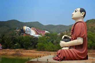 Photo: Huge sitting monk with the even bigger reclining Buddha in the background