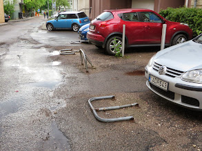 Photo: You lock these upright to save your parking space