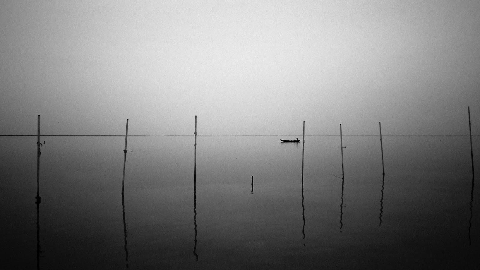 photograph of a boat alone on the water