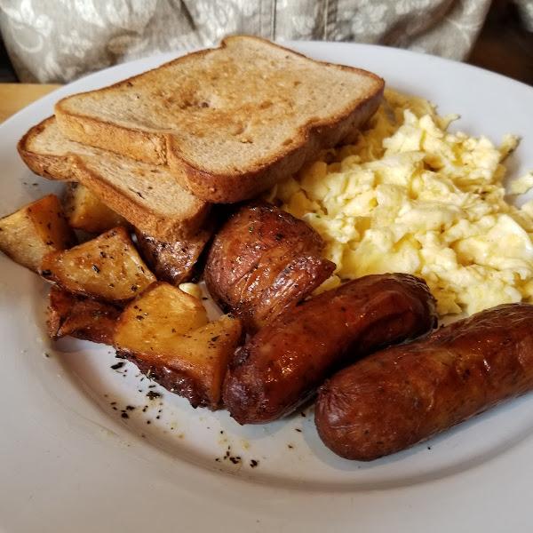 My husband had scrambled eggs, hashbrowns and sausage.