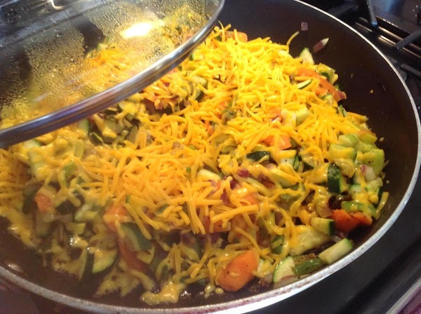Now add all but 1/2 cup of the shredded cheddar cheese, cover and allow...