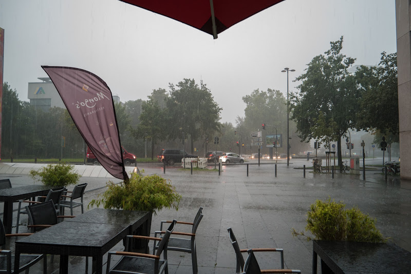 Heavy rainfall left us searching for cover under umbrellas of Mongo's Restaurant after being kicked out of the Köln Triangle lobby