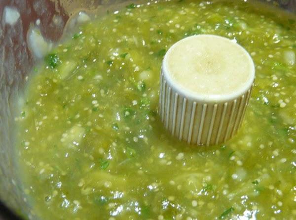 In food processor puree tomatillos, green chilis & cilantro.Add to crockpot.
