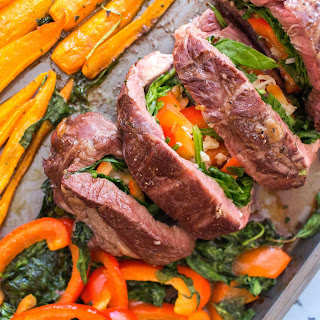Oven Roasted Red Peppers, Spinach, and Cheese Stuffed Steak with Glazed Carrots.