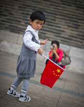 Photo: A Child in Tiananmen Square, China  After I left the exciting-sounding (but actually cool) Beijing City Planning museum, I walked under the street to get to Tiananmen Square.  There were thousands of people out celebrating a national holiday.  Kids, parents, families, and all sorts of festive activity.  Asian kids are always cute aren't they?  You just can't get away from it...  I found this little one with a busy mom snapping away nearby. Everyone was taking photos everywhere.... it was kind of crazy.  I knelt down to grab this one before moving on to find more cute kids.  from Trey Ratcliff at www.stuckincustoms.com