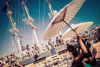Photo: A sunny day above umbrellas and ships...